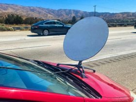 toyota-prius-driver-pulled-over-for-starlink-dish-on-the-hood,-surprised