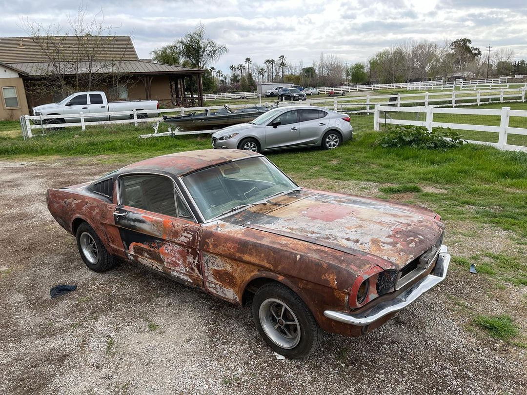 1965-ford-mustang-fastback-still-has-original-prairie-bronze,-also-some-rust