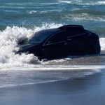 tesla-model-x-gets-stuck-in-the-sand-in-unknown-circumstances,-has-a-tide-wash