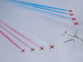 raf's-red-arrows-flank-the-mighty-submarine-hunter-poseidon-in-joint-flypast