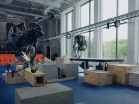 atlas-the-robot-works-its-hydraulic-joints,-nails-parkour-demonstration
