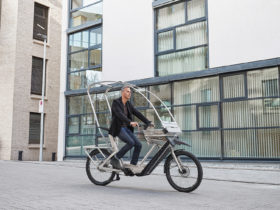 the-allweatherbike-is-a-convertible-e-bike-that-shelters-you-from-the-rain,-cold