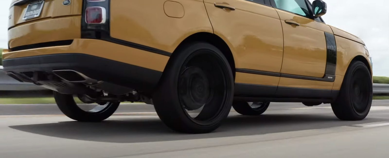 yellow-range-rover-fifty-edition-on-24-inch-vossen-wheels-looks-like-it's-floating