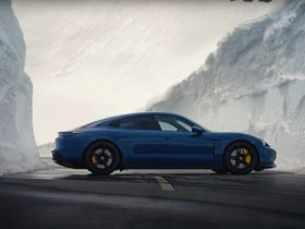 jumping-over-a-porsche-taycan-parked-between-snow-walls-is-not-a-job-for-everyone