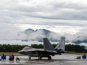f-22-raptor-looks-unimpressed-by-wall-of-clouds-moving-in-to-engulf-it