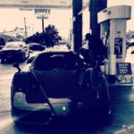 swizz-beatz-spotted-pumping-gas-into-his-limited-edition-ferrari-enzo