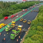 world's-largest-unmanned-road-construction-fleet-operates-on-busy-highway-in-china