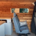 converted-ford-transit-is-a-four-wheeled-chameleon,-can-be-a-camper,-party-or-cargo-van