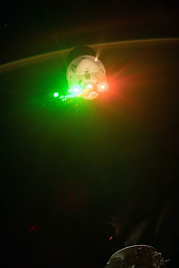 cargo-dragon-lights-up-in-red-and-green-as-it-leaves-the-iss